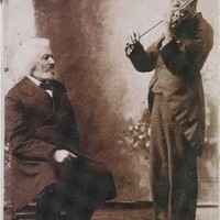 Frederick Douglass with man playing a violin, October 31, 1894